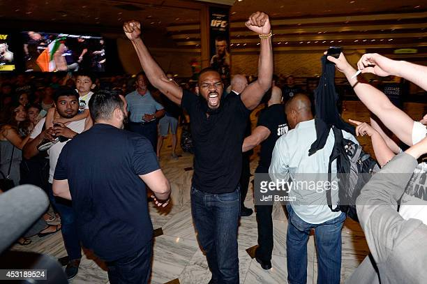 UFC light heavyweight champion Jon Jones yells to the crowd after facing off against challenger Daniel Cormier during the UFC 178 Ultimate Media Day...