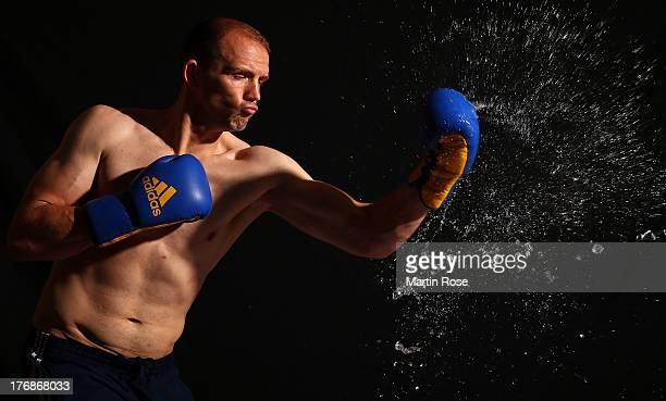 Light heavyweight fighter Juergen Braehmer of Germany poses during a photocall on August 7, 2013 in Guestrow, Germany.