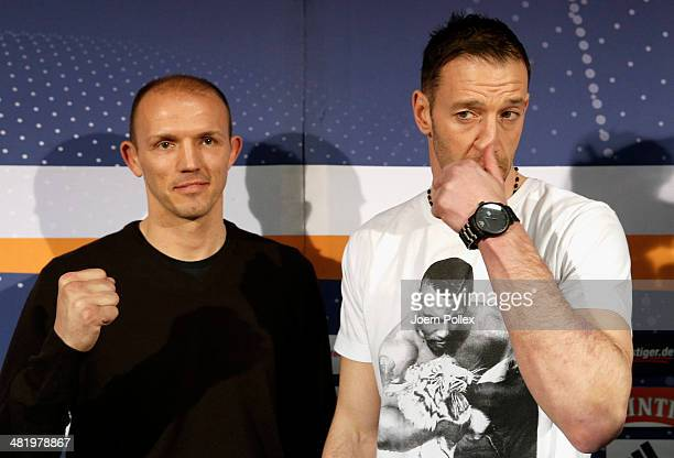 WBA light heavyweight world champion Juergen Braehmer of Germany and Enzo Maccarinelli of Wales are posing after the press conference ahead of the...