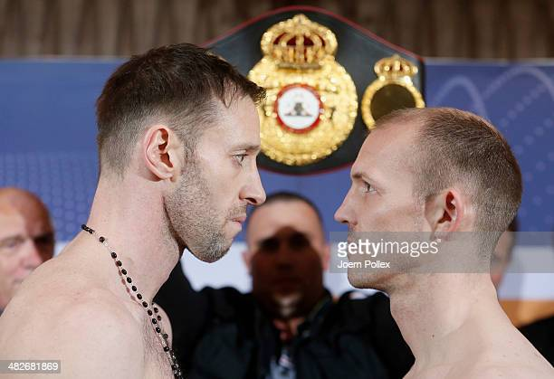 WBA light heavyweight world champion Juergen Braehmer of Germany and Enzo Maccarinelli of Wales pose during the official weigh in for their WBA Light...