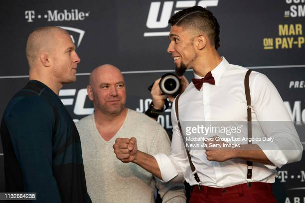 UFC light heavyweights Misha Cirkunov left and Johnny Walker square off as UFC President Dana White looks on during UFC 235 Ultimate Media Day at the...