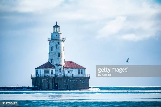 light house in frozen lake - ken ilio stock pictures, royalty-free photos & images