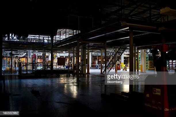 Light illuminates a disused part of the production floor at the Saab Automobile plant owned by National Electric Vehicle Sweden AB in Trollhaettan...