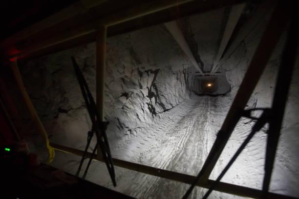 A light illuminates an underground tunnel at a copper mine