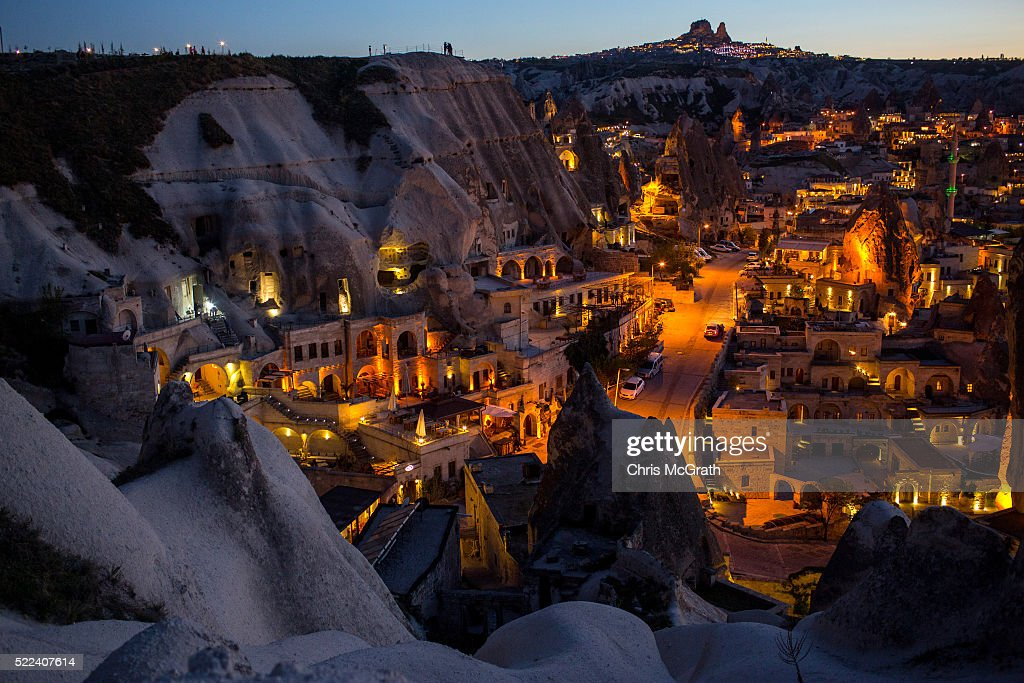 Light illuminates cave hotels at sunset in the town of Goreme on April 17, 2016 in Nevsehir, Turkey. Cappadocia, a historical region in Central Anatolia dating back to 3000 B.C is one of the most famous tourist sites in Turkey. Listed as a World Heritage Site in 1985, and known for its unique volcanic landscape, fairy chimneys, large network of underground dwellings and some of the best hot air ballooning in the world, Cappadocia is preparing for peak tourist season to begin in the first week of May. Despite Turkey's tourism downturn, due to the recent terrorist attacks, internal instability and tension with Russia, local vendors expect tourist numbers to be stable mainly due to the unique activities on offer and unlike other tourist areas in Turkey such as Antalya, which is popular with Russian tourists, Cappadocia caters to the huge Asian tourist market.