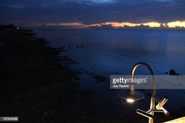 09 A light illuminates the dry shoreline of lake Okeechobee July 9 2007 in Pahokee Florida The lake has seen record low levels this year with...