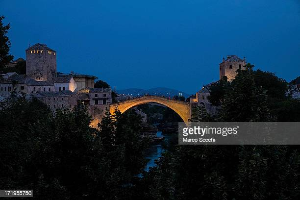 Light illuminates the Old Bridge standing as the city of Mostar remembers the 1993 conflict on June 28, 2013 in Mostar, Bosnia and Herzegovina. The...
