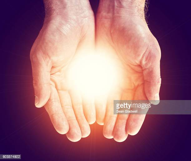 light in hands - praying hands stock pictures, royalty-free photos & images