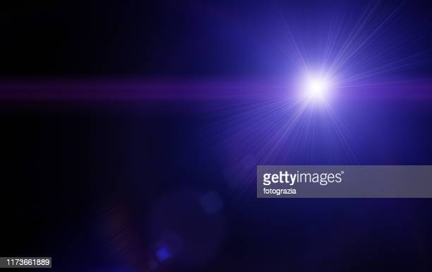 light in the dark - lens flare stock pictures, royalty-free photos & images