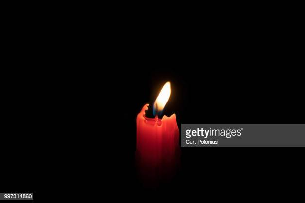 light in the dark - candle in the dark stock pictures, royalty-free photos & images