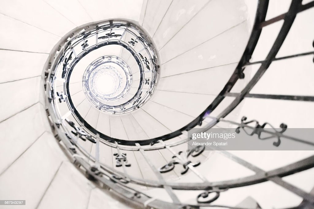 Light in the end of a spiral staircase : Stock Photo