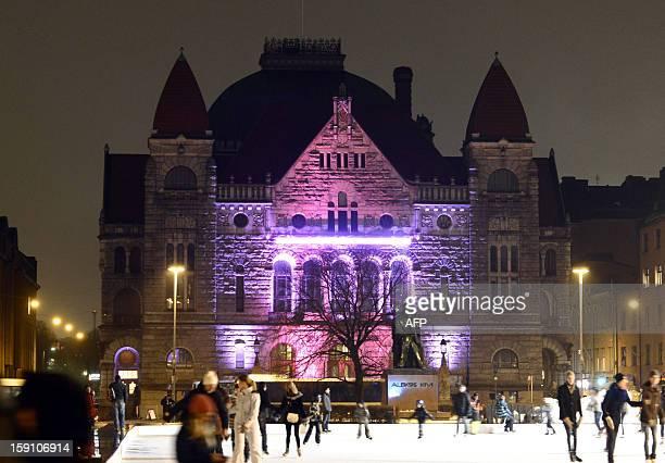 A light installation illuminates the National Theater during the Lux Helsinki festival in Helsinki Finland on January 7 2013 Thirteen light...