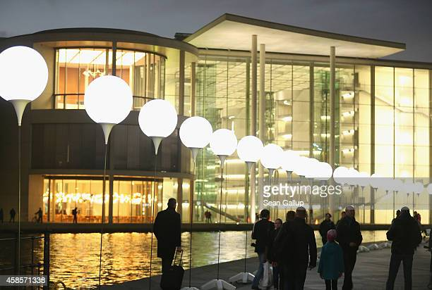 A light installation of balloons tethered to lamps illuminates the course of the Berlin Wall along the Spree River near government buildings two days...