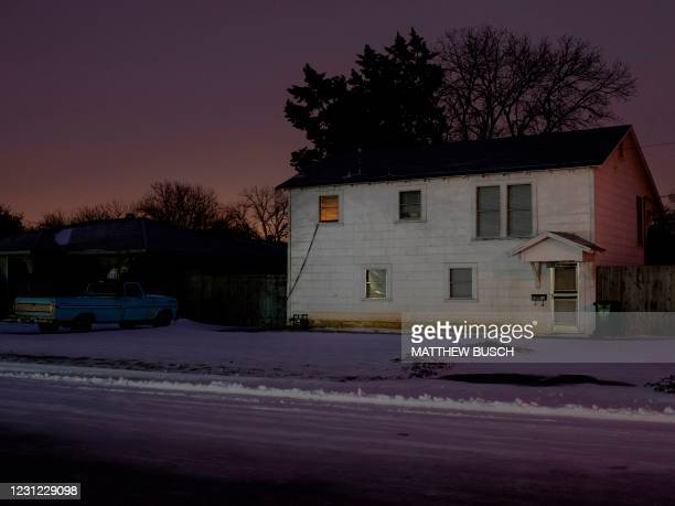 Light is seen from a house in Waco, Texas as severe winter weather conditions over the last few days has forced road closures and power outages over...
