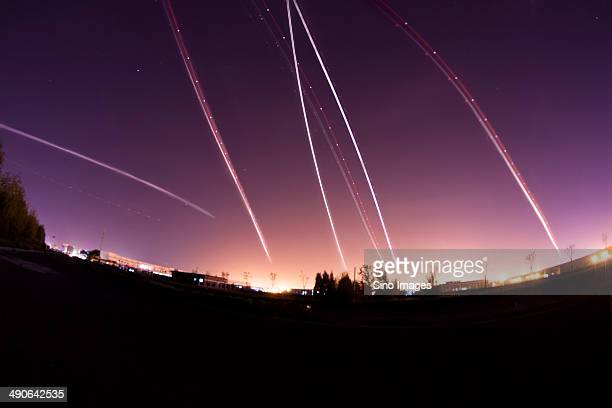 Light of a Few Flying Planes Forming Beautiful Arc