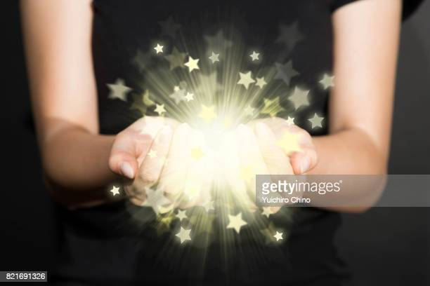 Light of stars in hands