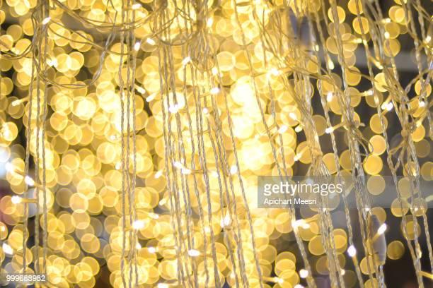light on christmas tree with bokeh for christmas and new year da