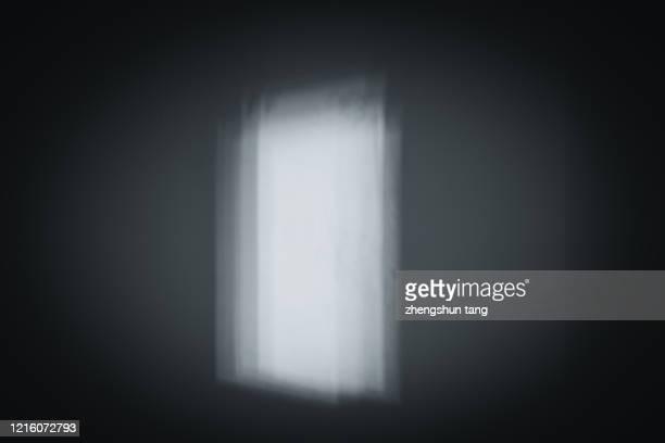 light on the empty studio wall background - 影のみ ストックフォトと画像