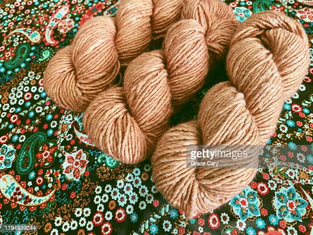 light orange yarn for knitting and crocheting - knitting stock pictures, royalty-free photos & images