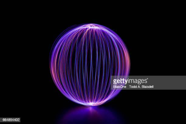 light painted orb - lichtmalerei stock-fotos und bilder