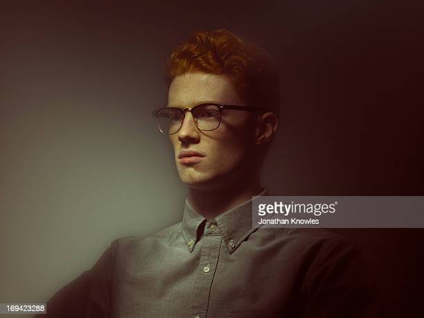 Light painted portrait, red hair male with glasses