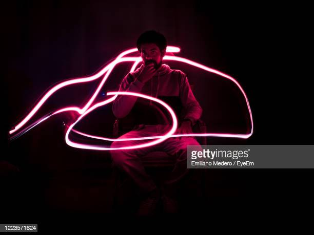 light painting against black background - one man only stock pictures, royalty-free photos & images