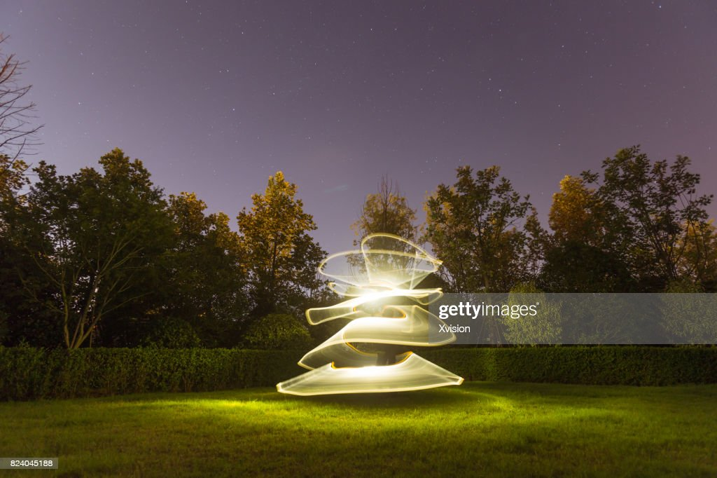 Light painting in the grass field in nature background : Stockfoto