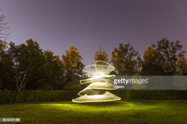 Light painting in the grass field in nature background