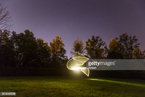 light painting in the grass field in nature background - educational subject stock photos and pictures