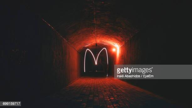 Light Painting In Tunnel At Night