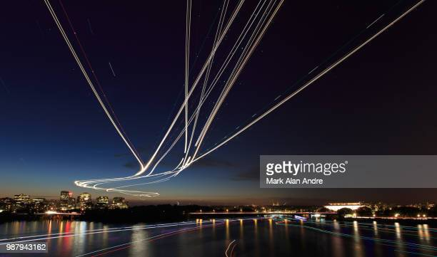light painting on the water and in the air - light trail stock pictures, royalty-free photos & images