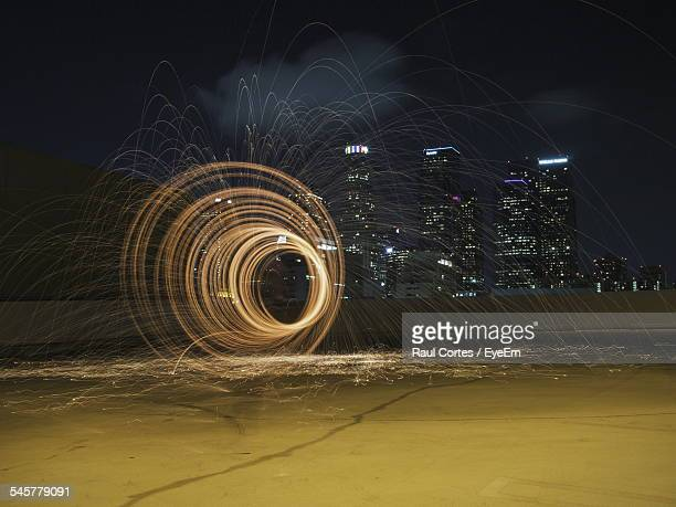 Light Painting Over Pond At Night