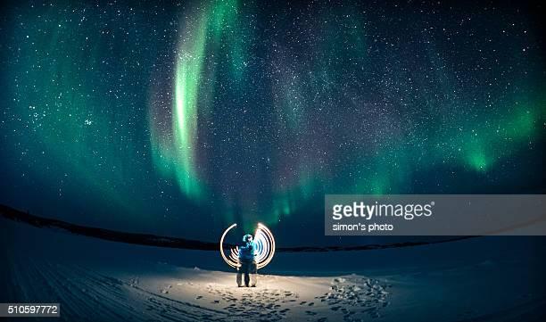 light painting under aurora
