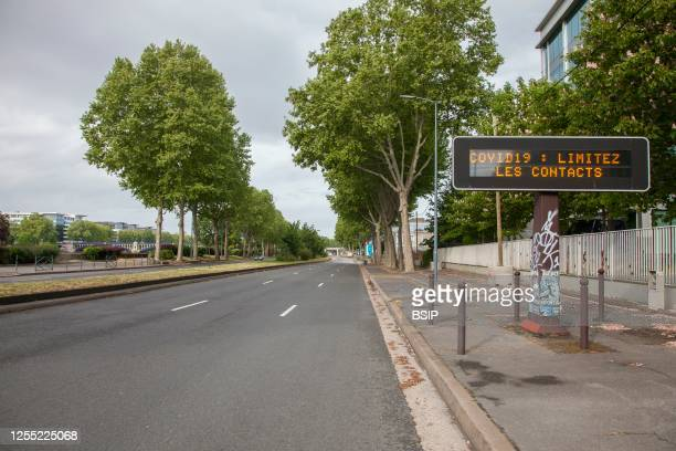 Light panels inviting to limit contacts during the health crisis related to coronavirus, at the edge of the empty road on the quay of Seine in...