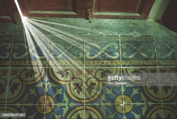 light passing through doorway onto tiled floor, overhead view - ajar stock pictures, royalty-free photos & images