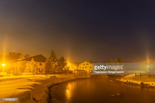 Light pillars phenomenon in the village of Celerina, Engadine valley, Canton of Grisons, Switzerland, Europe.
