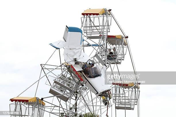 A light plane crashed into the Ferris wheel at Old Bar near Taree on the NSW North Coast Rescue workers were able to free the passenger and pilot as...