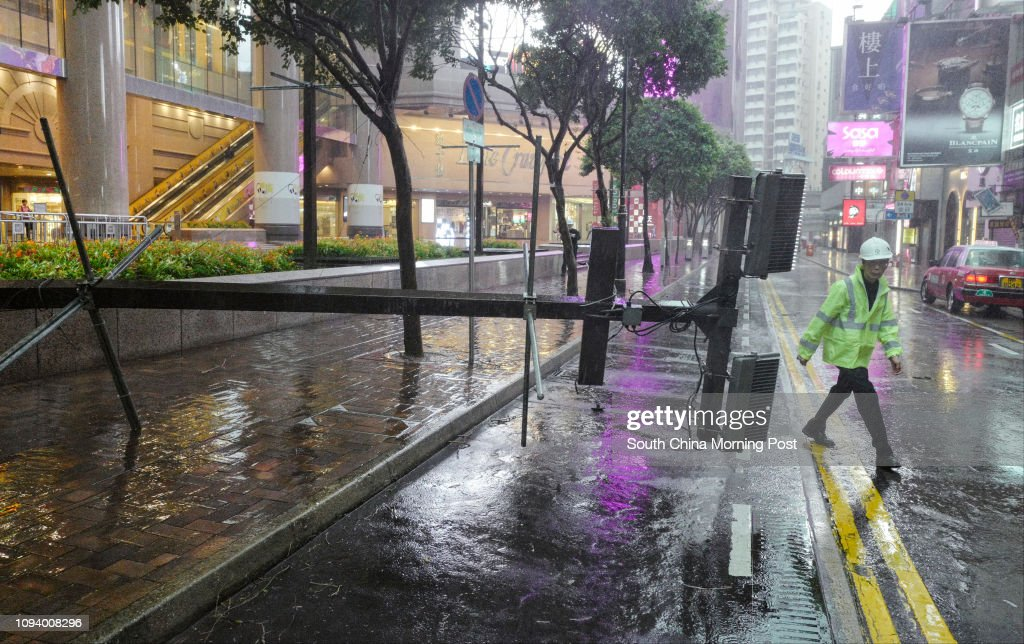 3672b772104 A light pole collapsed at Times Square in Causeway Bay as Typhoon Hato hits  Hong Kong