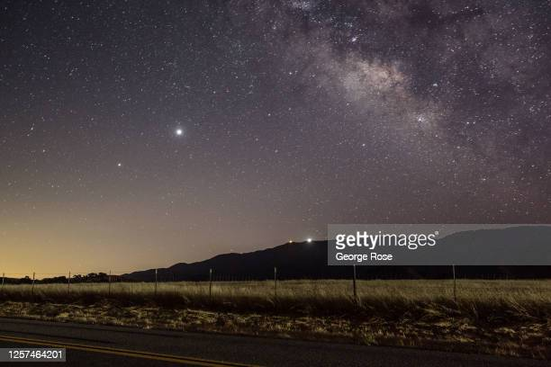 Light pollution from nearby Santa Barbara takes on the appearance of a sunrise as viewed at 11 p.m. On July 14 near Santa Ynez, California. The...