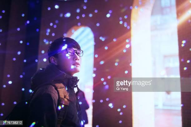 light projected on young man face - international landmark stock-fotos und bilder