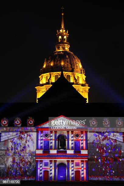 A light projection illuminates the facade of the Hotel des Invalides in Paris during the show '1918The Rise Of A New World' on June 25 2018 /...