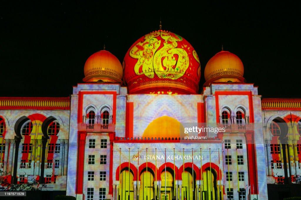 Light projection on Istana Kehakiman at Festival Light And Motion Putrajaya (LAMPU) 2019 for new year celebration in Putrajaya. : Stock Photo