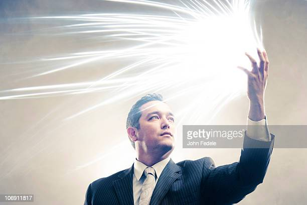 Light radiating from Japanese businessman's hands