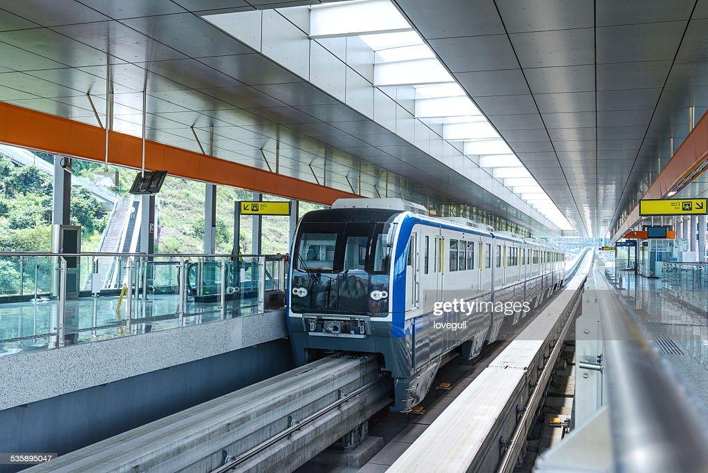 light rail train in station platform : Bildbanksbilder