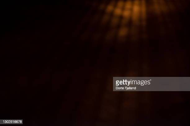 light shadow from a fence on a dark street - dorte fjalland fotografías e imágenes de stock