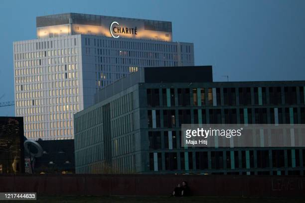 Light shines from Charite Hospital as the coronavirus pandemic continues on April 07 2020 in Berlin Germany The number of confirmed coronavirus cases...