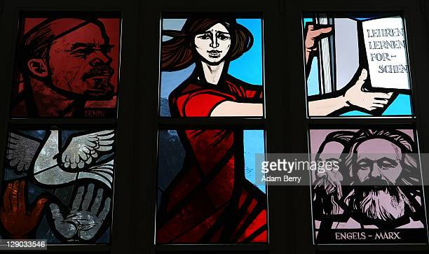 Light shines through stained glass windows featuring the faces of Karl Marx, Friedrich Engels and Vladimir Ilyich Lenin prior to the beginning of the...