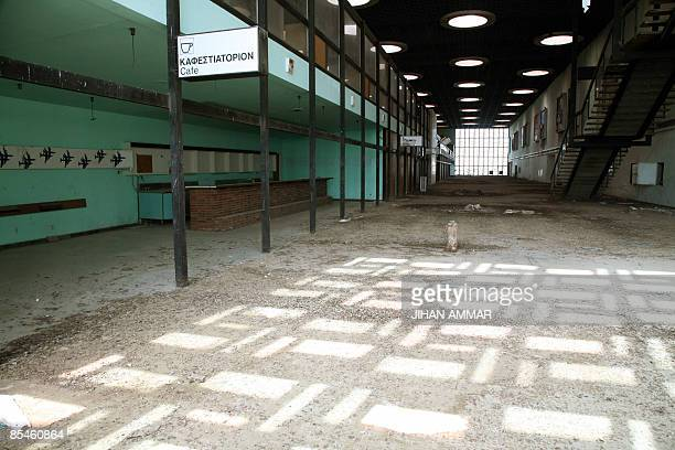 Light shines through the windows inside the empty main hall of the decaying Nicosia International Airport, on March 17, 2009. Closed since 1974...