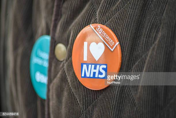 Light shining on a badge at the picket line Manchester Royal Infirmary in Manchester Greater Manchester England United Kingdom on Tuesday 26th April...