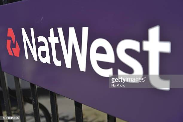 Light shining on a sign for the Natwest Bank in Stockport Greater Manchester England United Kingdom on Wednesday 20th April 2016